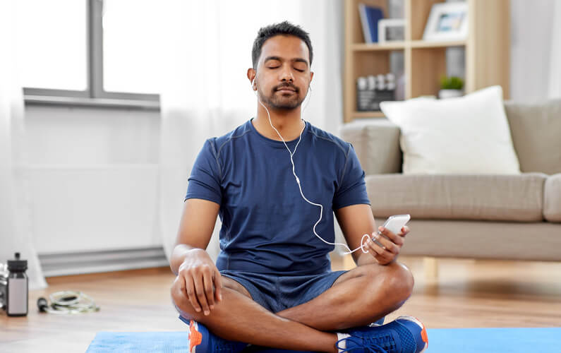 Man meditating to a meditation app for self care